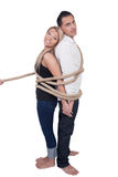 Couple bound together by a rope Stock Photos