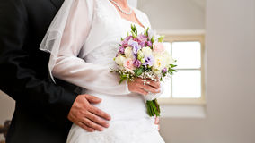 Couple with a bouquet Royalty Free Stock Image