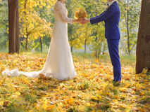 Couple with Bouquet of Dry Leaves Royalty Free Stock Photos