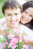 Couple with bouquet of flowers Royalty Free Stock Image