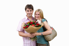 Couple with bouquet of flowers, smiling, portrait, cut out Stock Photos