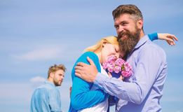 Couple with bouquet romantic date. Ex husband jealous on background. Couple in love dating outdoor sunny day, sky stock image