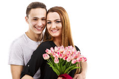 Couple with a bouquet of tulips, valentines day theme Stock Photo