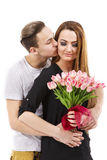 Couple with a bouquet of tulips, valentines day theme Royalty Free Stock Image