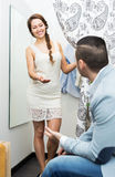Couple at boutique changing cubicle Royalty Free Stock Photography