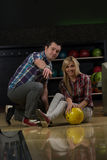 Couple In A Bowling Alley Royalty Free Stock Photos