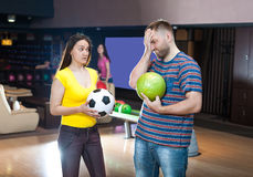 Couple with bowling balls Royalty Free Stock Photo