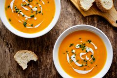 Spicy Homemade Pumpkin Soup. Couple of bowls of homemade soup with organic vegetables Stock Photography