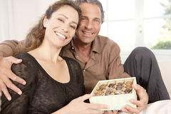 Couple with box of chocolates. Royalty Free Stock Photo