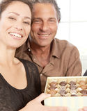 Couple with box of chocolates. Stock Photography