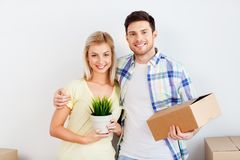 Couple with box and flower moving to new home royalty free stock image