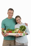 Couple with box of vegetables, smiling, portrait, cut out Stock Images