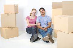 Couple between boxes Stock Photos