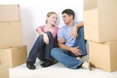 Couple between boxes Royalty Free Stock Photo