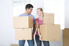 Couple with boxes Stock Images