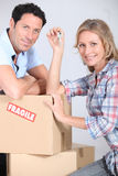 Couple with boxes. As they move house Stock Photo