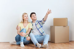 Couple with boxes moving to new home and dreaming Royalty Free Stock Photography