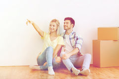 Couple with boxes moving to new home and dreaming Royalty Free Stock Images