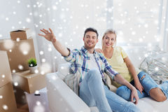 Couple with boxes moving to new home and dreaming Stock Photo