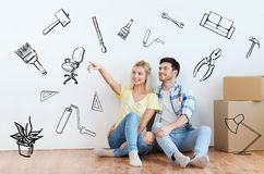 Couple with boxes moving to new home and dreaming Royalty Free Stock Photo