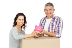 Couple with boxes and piggy bank Stock Photos
