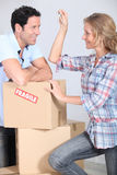 Couple with boxes smiling Royalty Free Stock Photo