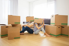 Couple with boxes on their heads Royalty Free Stock Images