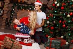 Couple ,boy in Christmas interior Stock Photos