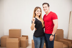 Couple with a brand new home. Portrait of an attractive young couple holding the keys to their new apartment Stock Images