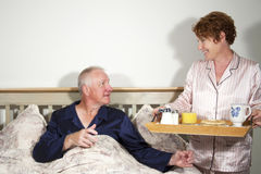Couple with breakfast in bed Royalty Free Stock Photography