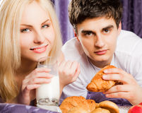 Couple breakfast bed milk moustache Royalty Free Stock Photos
