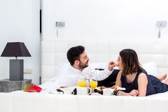 Couple at breakfast in hotel room. Stock Images