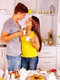 Couple breakfast at kitchen. Happy couple breakfast at kitchen Royalty Free Stock Images