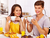Couple breakfast at kitchen. Happy couple breakfast at kitchen Royalty Free Stock Photos