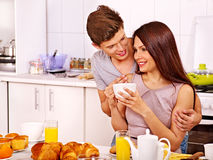 Couple breakfast at kitchen. Royalty Free Stock Image