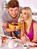 Couple breakfast at kitchen. Happy couple breakfast of cake at kitchen Stock Photo