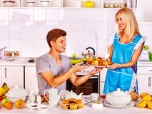 Couple breakfast at kitchen. Happy couple breakfast croissant at kitchen Royalty Free Stock Image