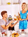 Couple breakfast at kitchen. Happy couple breakfast of croissant at kitchen Stock Photo
