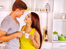 Couple breakfast at kitchen. Happy couple breakfast and drink coffee at kitchen Stock Photography