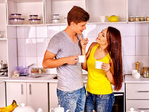 Couple breakfast at kitchen. Happy couple breakfast and drink tea at kitchen Stock Photography