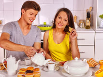 Couple breakfast at kitchen. Happy couple breakfast at kitchen. Joint preparation of breakfast Stock Photo