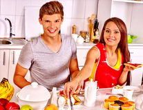 Couple breakfast at kitchen. Happy couple breakfast at kitchen. Woman in red shirt Royalty Free Stock Photo