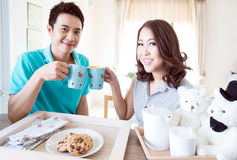 Couple with breakfast Stock Images