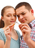 Couple breaking apart cigarette Stock Images
