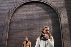 Couple breakup sad girl relationship conflict. Couple breakup. Sad girl. Difficult relationship. Conflict problems concept. Brick wall free space background Royalty Free Stock Image