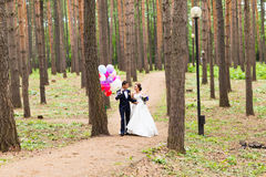 Couple of bride and groom with balloons Royalty Free Stock Images