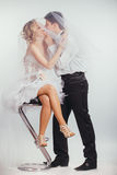 Couple of bride and groom covered with veil Stock Photos