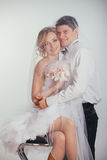 Couple of bride and groom covered with veil Stock Image
