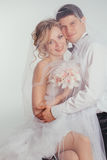 Couple of bride and groom covered with veil Stock Photo