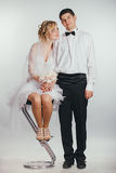 Couple of bride and groom covered with veil Stock Images